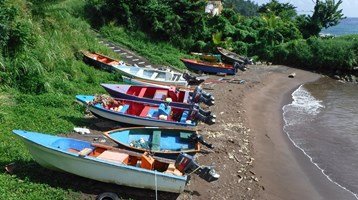 fishing boats on a beach in Dominica
