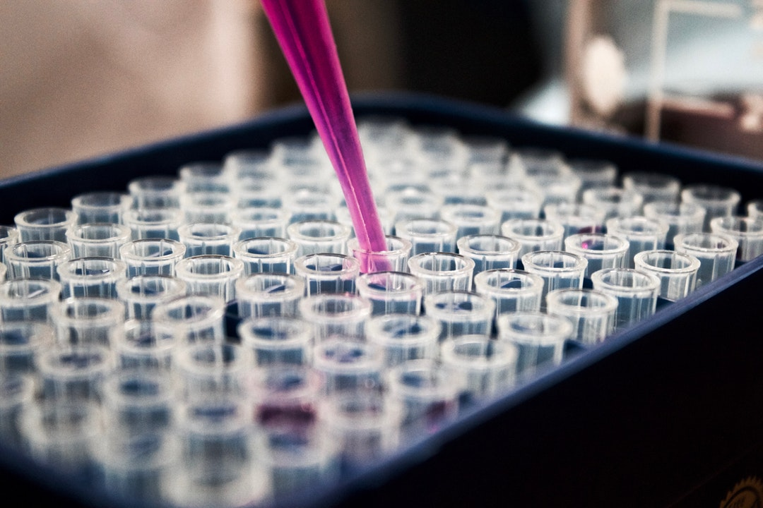 pipette over test tubes