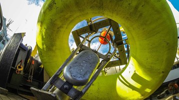 a smartbuoy - floatable scientific device - on the deck of a ship